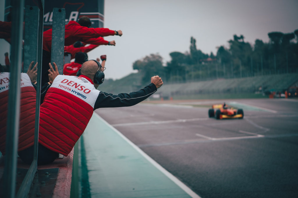 "Team ""PS Racing by Coloni Motorsport"" celebrating the Championship of Mahaveer Raghunathan."