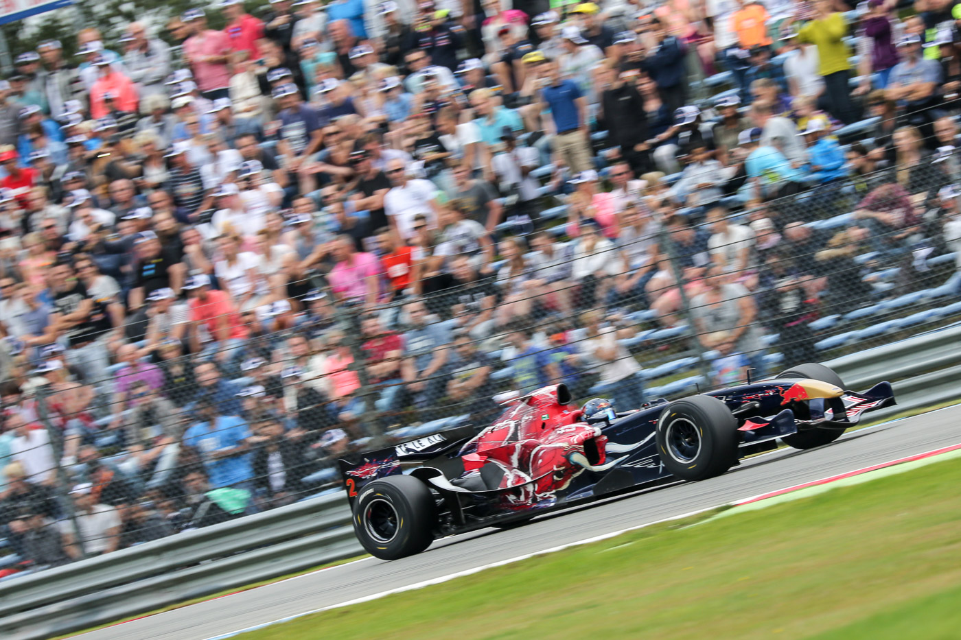 Ingo Gerstl in his STR1-F1 car in front of a packed crowd